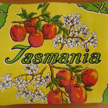 Vintage souvenir tablecloth, Tasmania, yellow and green with red apples and four maps. Square tablecloth