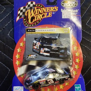 Winners circle Dale Earnhardt SR. Die cast car and card collector set.