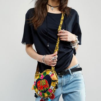 Reclaimed Vintage Embroidered Heart Cross Body Bag at asos.com