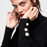 SWEATER WITH FAUX PEARLS AT CUFFSDETAILS