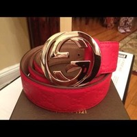 Authentic all red Gucci belt with gold buckle
