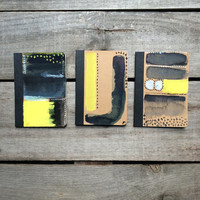 Blue, black & yellow pocket hand painted notebook with an original painting