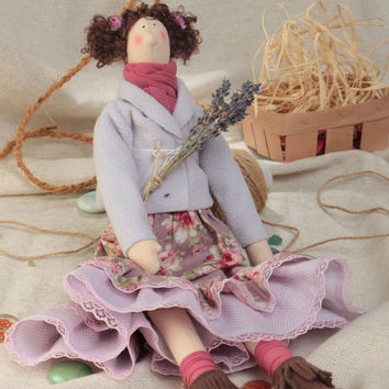 Handmade designer small fabric soft doll with curly hair in violet color palette