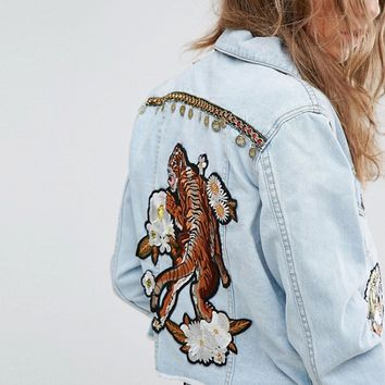 Kiss The Sky Customized Denim Trucker Jacket With Tiger And Coin Embellishment at asos.com