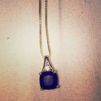 14k gold necklace with blue sapphire