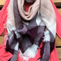 Our 'Autumn Nights Blanket Scarf '' Heavyweight scarf has beige, white, and burgundy plaid with fringe. 100% Acrylic.