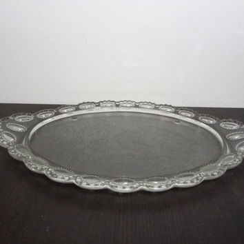 Vintage L.E. Smith Clear and Textured Glass Oval Footed Vanity Tray, Serving Platter with Medallion Design Border