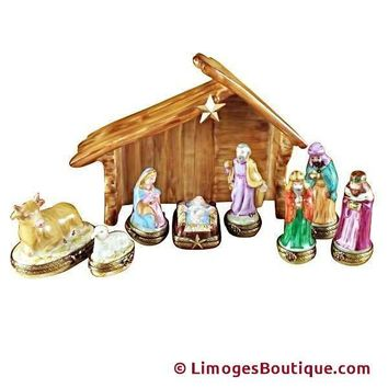 EIGHT PIECE MINI HINGED NATIVITY W/ PORCELAIN STABLE LIMOGES BOX