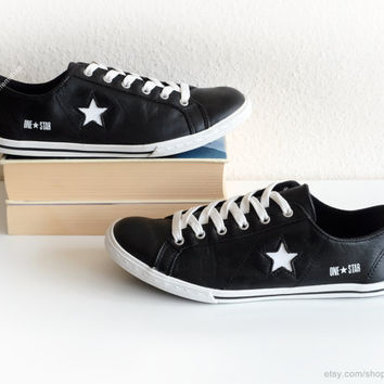 Black leather Converse One Star low tops, vintage leather sneakers, black trainers with white laces. Size 40 (UK 6, US wo's 8.5, US men's 7)