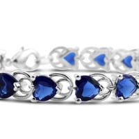 Silver Toned Blue Sapphire CZ Heart Shaped Tennis Bracelet
