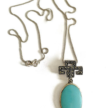 """Sterling Silver, Bezel Set Turquoise Oval Pendant with Native American Marcasite Symbol suspended from a  Sterling 18"""" Box Chain"""