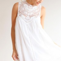 HEARTLINES DRESS - Sleeveless white lace detailed dress with high sheer neckline