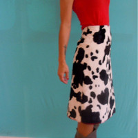 vintage 80's black and white cow print knee by HarlowsVintage