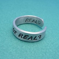 Hunger Games Inspired - Real Or Not Real. Real - A Double Sided Hand Stamped Aluminum Ring