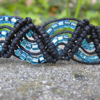 Eye-Catching Black Macramé Bracelet with Bright Blue Beads