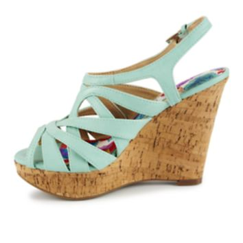 Xappeal Journee Women's ShoeTake the next step toward trendy style in the Journee women's shoe from Xappeal! It won't take long to get there thanks to a sleek, super-strappy silhouette and a cork-inspired wedge heel that creates lithe length through the le