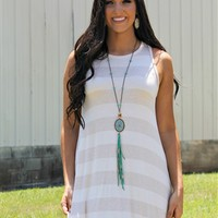 Our Time & Tide Dress - Oatmeal is just sweet and simple! It is a striped sleeveless tunic dress. It is flowy and not lined.​