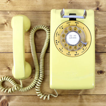 vintage hanging rotary telephone // two-toned yellow