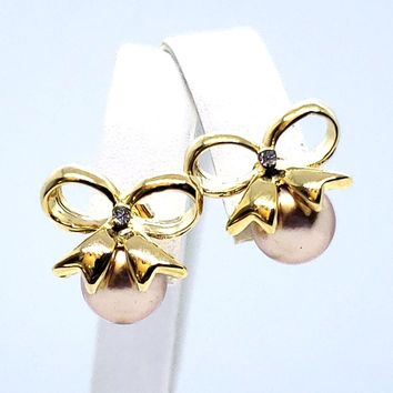 (1-1011-h9-1) Gold Plated Bronze Pearl Bow Earrings.