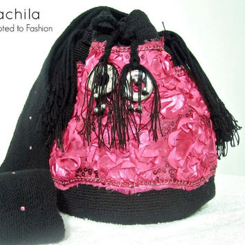 Handmade Wayuu bag decorated with Swarovski stones and silk fabrics.