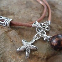 SEAFISH & LEATHER leather wrap bracelet in cinnamon with palm seeds