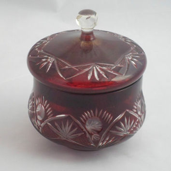 Lidded bon-bon dish in flashed ruby glass cut to clear. Attractive hand cut naive pattern on a practical and decorative centre piece