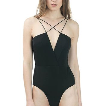 This sleek bodysuit features a leatherette bustier upper and solid poly-spandex blended underwear design, deep v-neckline with criss-cross elastic shoulder straps, and open back construction. Finished with a hidden back zip-up closure, eye hooks and double
