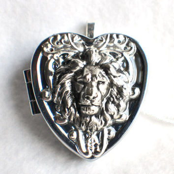 Music box locket, heart shaped locket with music box inside, in silver with lion and silver filigree.