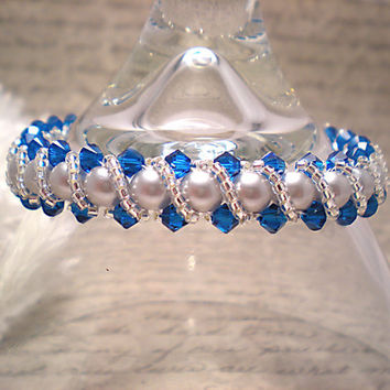 The Stella- Swarovski Silver Pearl and Swarovski Capri Crystal Braided Bracelet with Twisting Seed Bead Overlay