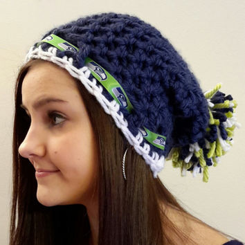 crochet Seahawks inspired hat. with pom pom. Made by Bead Gs on Etsy. blue and white. Ladies size.