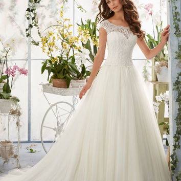 Embroidered Lace Overlays the Bateau Bodice on Soft Net Morilee Bridal Wedding Dress | Style 5403 | Morilee
