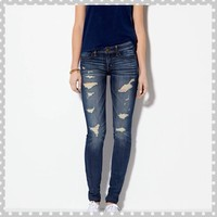 Distressed dark wash super jeggings