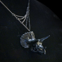 black painted plastic triceratops skull necklace with asymmetrical gunmetal and black toned chain gradient