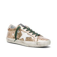 Golden Goose Superstar Low Sneakers in Gold & Emerald | FWRD