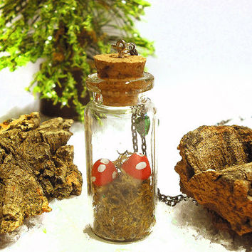 Terrarium necklace bottle with small mushrooms handmade in cold porcelain and green moss