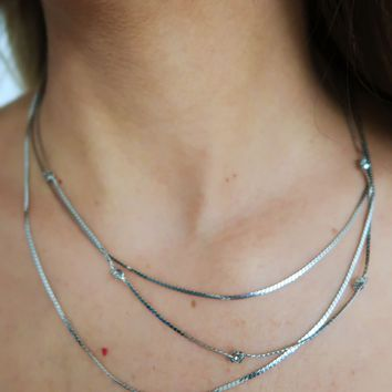 Keep Them Wondering Necklace: Silver