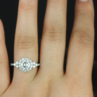 Amora 14kt White Gold Round FB Moissanite and Diamonds Halo Heart Shape Detail Engagement Ring (Other metals and stone options available)