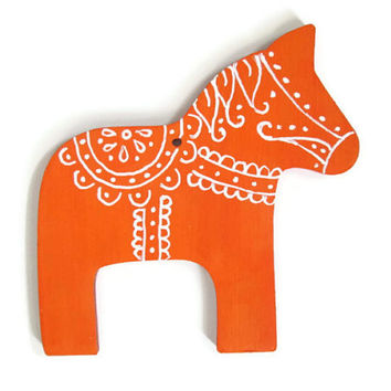 Orange Dala Horse ornament with white hand painted floral designs traditional Swedish wood Christmas ornament