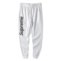 Supreme New fashion letter print sports leisure couple pants trousers White