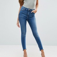ASOS RIDLEY Skinny Jeans In Roy Dark Stonewash with Stepped Hem at asos.com