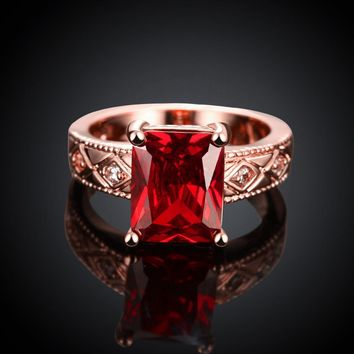 Ruby Emerald Cut Center Halo Ring in 18K Rose Gold