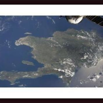 A view of the Caribbean island of Hispaniola from the International Space Station., framed black wood, white matte