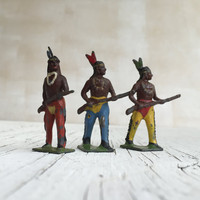 Britains metal die-cast American Indians. A set of 3 miniature metal die-cast toys from the famous English company. Circa 1930s.