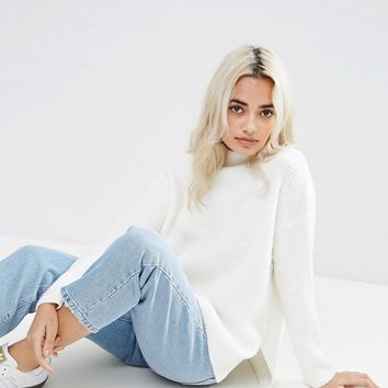 ASOS PETITE Chunky Jumper With Turtle Neck In Fluffy Yarn at asos.com