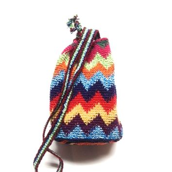 "This boho/hippie chic style hand made drawstring bucket bag features a textured feel Chevron Pattern throughout, adjustable drawstring closured with wooden beaded detailing, and self-tie adjustable shoulder with a 23"" drop."
