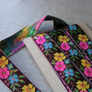 Floral Jacquard Ribbon, Wine Background with Hot Pink, Yellow and Turquoise Flowers, Touch of Gold Outline around Green Leaves.