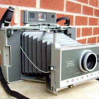 Vintage POLAROID Automatic 340 Land Camera by rememberwhencamera