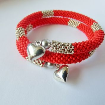 Red Bead Crochet Bangle with Metallic Silver Stripes. Bracelet on a Memory Wire with Heart Charms