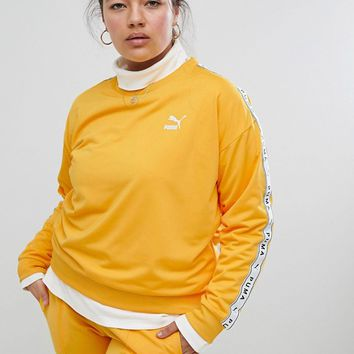 Puma Exclusive To ASOS Plus Sweatshirt With Taped Side Stripe In Yellow at asos.com