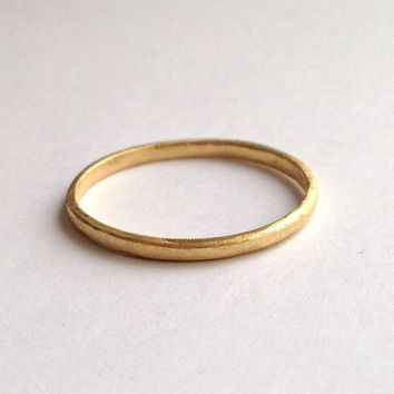 18 carat gold ring with organic texture simple wedding band delicate yellow 18k